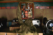 Pictures of exiled Tibetan leader, the Dalai Lama displayed discreetly in a Tibetan home.