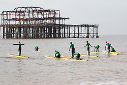 © Licensed to London News Pictures. 15/01/2016. Brighton, UK. Members of the Brighton Surf Life Saving Club brave the cold temperatures for their weekly lessons. Today January 15th 2016. Photo credit: Hugo Michiels/LNP