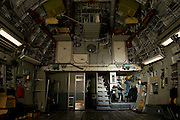 A U.S. Air Force loadmaster at her station in the cargo area during preflight...Air Force aircraft transport most of the supplies and military equipment to the combat zone. Specialists must weigh, sort and load all of the gear before it heads to its location abroad. Air Force loadmasters and pilots ensure the safe transport of all equipment required in the field.