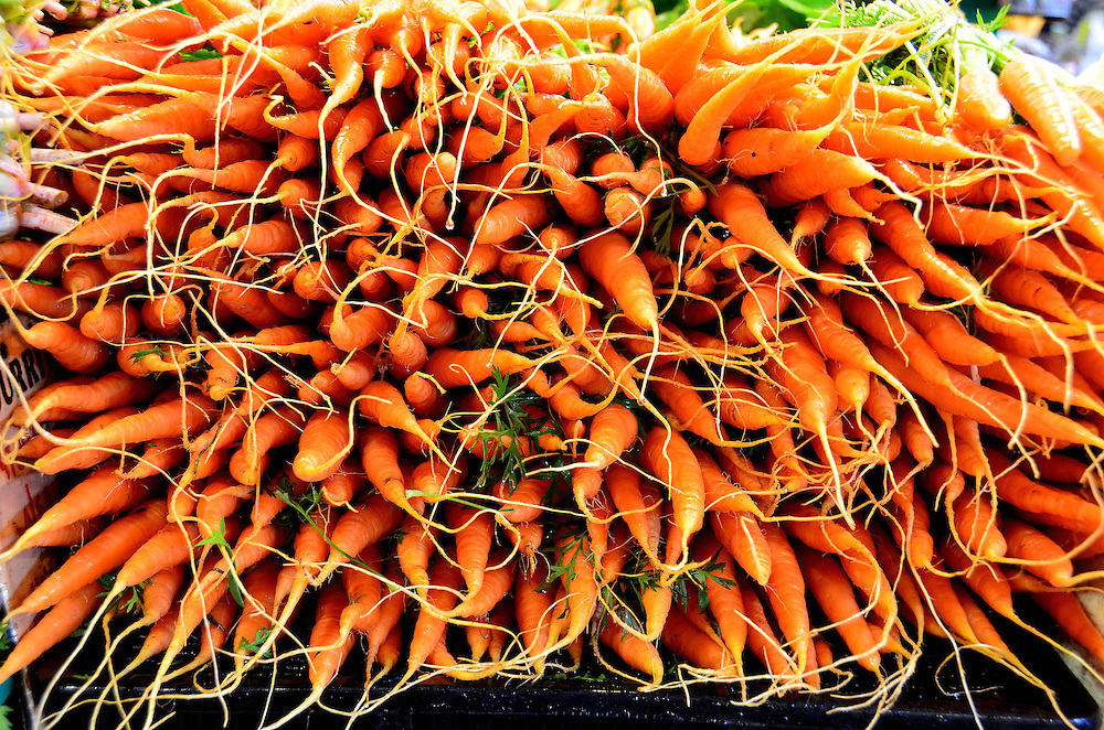 Orange Carrots with Roots at Farmers Market in Vancouver, Canada