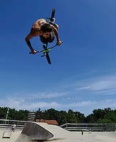 Dallas Weimer of Fond du Lac, flips and rolls over the cement ramps of the Fond du Lac skate park. Friday, June 14, 2013. Patrick Flood/The Reporter Media.