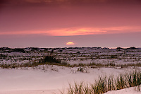 A wide angle view of a sunset, as seen on a Autumn evening from Schiermonnnikoog island, the Netherlands.