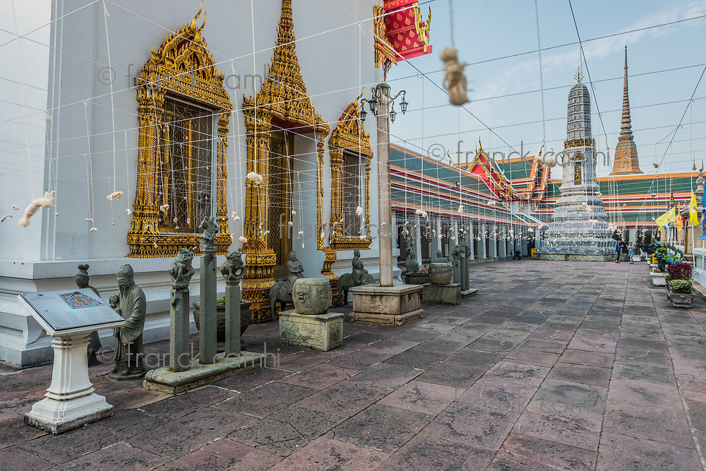 Bangkok, Thailand - December 31, 2013: teens walking in Wat Pho temple at Bangkok, Thailand on december 31st, 2013