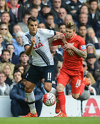 Erik Lamela of Tottenham Hotspur is challenged by Alberto Moreno of Liverpool - Mandatory byline: Dougie Allward/JMP - 07966 386802 - 17/10/2015 - FOOTBALL - White Hart Lane - London, England - Tottenham Hotspur v Liverpool - Barclays Premier League