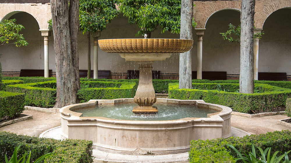 A fountain in a courtyard at the Alhambra Palace in Granada