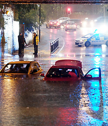 Kirkmanshulme Lane in Manchester was blocked with deep water submerging two cars<br /> <br /> Weather Pictures, Tuesday 13th September 2016<br /> <br /> (c) Alex Todd | Edinburgh Elite media