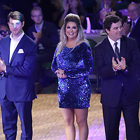Celebrity dancers from left, Jason Stacy, Amber Moyer, and Bennett Mize are introduced to the crowd Saturday at the Dancing Like the Stars event