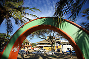 "SHOT 2/12/09 9:30:28 AM - An archway in the main town square in Sayulita, Mexico.  Sayulita is a small fishing village about 25 miles north of downtown Puerto Vallarta in the state of Nayarit, Mexico. Known for its consistent river mouth surf break, roving surfers ""discovered"" Sayulita in the late 60's with the construction of Mexican Highway 200. Today, Sayulita is a prosperous growing village of approximately 4,000 residents. Hailed as a popular off-the-beaten-path travel destination, Sayulita offers a variety of activities such as horseback riding, hiking, jungle canopy tours, snorkeling and fishing. Still a mecca for beginner surfers of all ages, the quaint town attracts upscale tourists with its numerous art galleries and restaurants as well. Sayulita has a curious eclectic quality, frequented by native Cora and Huichol peoples, travelling craftsmen as well as international tourists. Sayulita is the crown jewel in the newly designated ""Riviera Nayarit"", the coastal corridor from Litibu to San Blas. It's stunning natural beauty and easy access to Puerto Vallarta have made Sayulita real estate some of the most sought after in all of Mexico..(Photo by Marc Piscotty / © 2009)"
