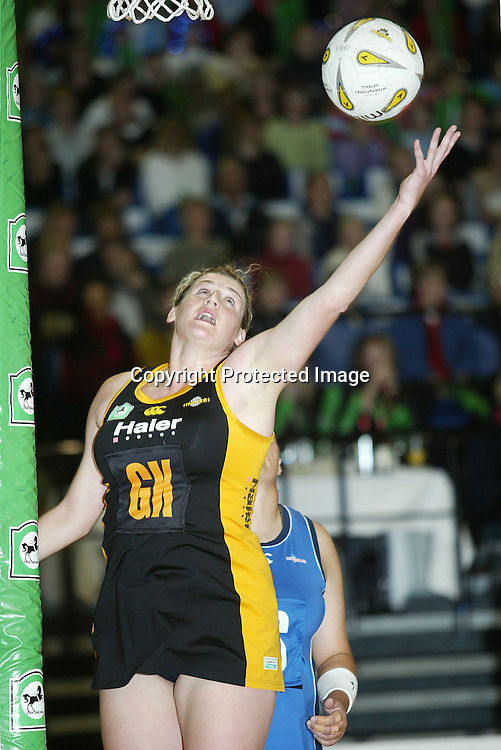 23 May 2004, Event Center, Wellington, National Bank Cup, Netball. Wellington Shakers vs Auckland Diamonds.<br />Shakers Megan Hutton takes a high pass during the Shakers 45-53 loss to the Diamonds on Sunday afternoon.<br />Please Credit: Marty Melville/Photosport