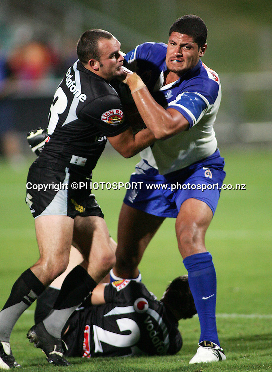 Bulldogs prop Willie Mason is fends off the tackle of Corey Lawrie during the preseason NRL match between the Vodafone Warriors and Bulldogs held at Albany Stadium, Auckland, on Saturday 3 March 2007. Photo: Renee McKay/PHOTOSPORT