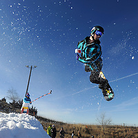 Cody Brown, 18, gets some air while snowboarding at Great Bear Recreation Park in Sioux Falls, S.D.