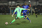 Sutton United Goalkeeper Ross Worner (1) clearing from AFC Wimbledon striker Tom Elliott (9) during the The FA Cup third round replay match between AFC Wimbledon and Sutton United at the Cherry Red Records Stadium, Kingston, England on 17 January 2017. Photo by Matthew Redman.