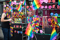 © Licensed to London News Pictures . 25/08/2017. Manchester , UK. Street sellers in Manchester's Gay Village at the opening night of Manchester Pride's Big Weekend . The annual festival , which is the largest of its type in Europe , celebrates LGBT life . Photo credit: Joel Goodman/LNP