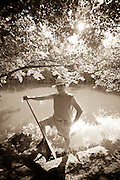 A paddler poses for a portrait by the Olentangy River in central Ohio.