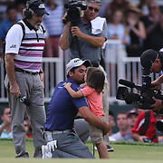 Jason Day, Australia, receives hugs and kisses from his son Dash after winning the The Barclays Golf Tournament by six shots at The Plainfield Country Club, Edison, New Jersey, USA. 30th August 2015. Photo Tim Clayton