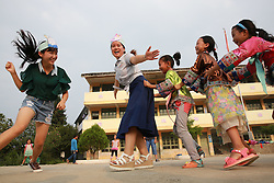 LIUZHOU, Sept. 7, 2016 (Xinhua) -- Wu Zhongyan (1st L) and Liang Haihuan (2nd L) play games with their students in Gaoma Village Primary School, where most students are ''left-behind children'', in Liuzhou, south China's Guangxi Zhuang Autonomous Region. The phrase is used in China to describe rural children whose parents work in other cities. Left-behind children usually live with relatives, often their grandparents, while their parents work away from home. . (Xinhua/Long Tao) (wyl) (Credit Image: © Long Tao/Xinhua via ZUMA Wire)