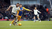 Joe Garner and Jamie O'Hara battle during the Sky Bet Championship match between Fulham and Preston North End at Craven Cottage, London, England on 28 November 2015. Photo by Pete Burns.