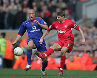 Photo: Lee Earle.<br /> Liverpool v Manchester United. The FA Cup. 18/02/2006. Liverpool's Steven Gerrard (R) battles with Mikael Silvestre.