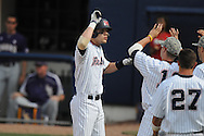 Mississippi's Matt Snyder hits a solo home run in the 8th inning vs. LSU at Oxford-University Stadium on Sunday, April 25, 2010 in Oxford, Miss. Ole Miss won 7-6 to sweep the three game series