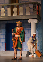 """Erronius played by Jake Adams arrives with Protean Anna Malek carrying his bag during dress rehearsal for Gilford High School's production of """"A Funny Thing Happened on the Way to the Forum"""" Tuesday evening.  (Karen Bobotas/for the Laconia Daily Sun)"""