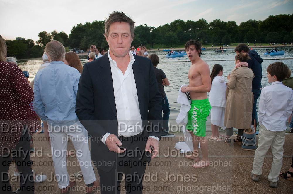 HUGH GRANT, Chucs Dive & Mountain Shop charity Swim Party: Lido at The Serpentine. London. 4 July 2011. <br /> <br />  , -DO NOT ARCHIVE-© Copyright Photograph by Dafydd Jones. 248 Clapham Rd. London SW9 0PZ. Tel 0207 820 0771. www.dafjones.com.