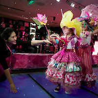 SHANGHAI, JUNE-14 :  foreign children perform on the catwalk during the daily fashion skow for kids inside the newly opened Barbie store in Shanghai.