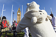 Demonstrators at Parliament Square during the Time To Act, National Climate March organised by Campaign Against Climate Change in London, England on March 7, 2015