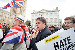 © Licensed to London News Pictures. 01/06/2013. Westminster, UK BNP leader Nick Griffin addresses a rally of supporters outside the Houses of Parliament. Police were forced to separate rival protests by the BNP and anti-fascist groups in Whitehall. Photo credit : Luca Marino/LNP