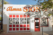 Ascus Sign shop and Harpers Point in the Old Town historic shopping and restaurant district in Fort Collins, Colorado.
