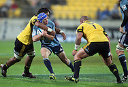 Blues Lachie Munro is tackled by Faifili Lavave. Super Rugby - Hurricanes v Blues at Westpac Stadium, Wellington, New Zealand on Friday 6th May 2011. PHOTO: Grant Down / photosport.co.nz