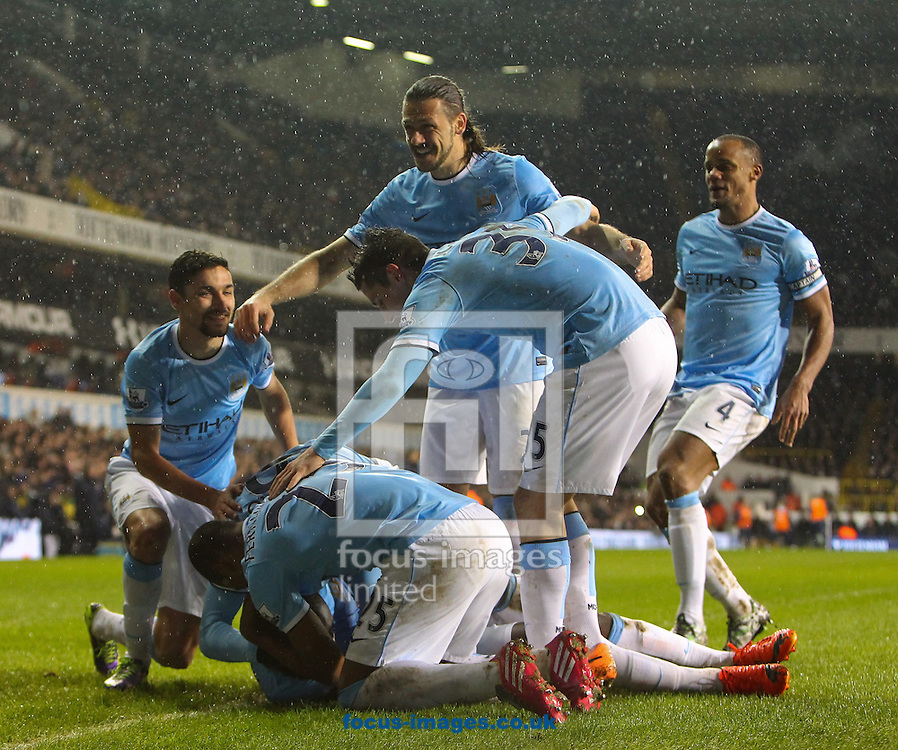 Picture by John Rainford/Focus Images Ltd +44 7506 538356<br /> 29/01/2014<br /> Yaya Toure of Manchester City celebrates scoring with team-mates during the Barclays Premier League match at White Hart Lane, London.