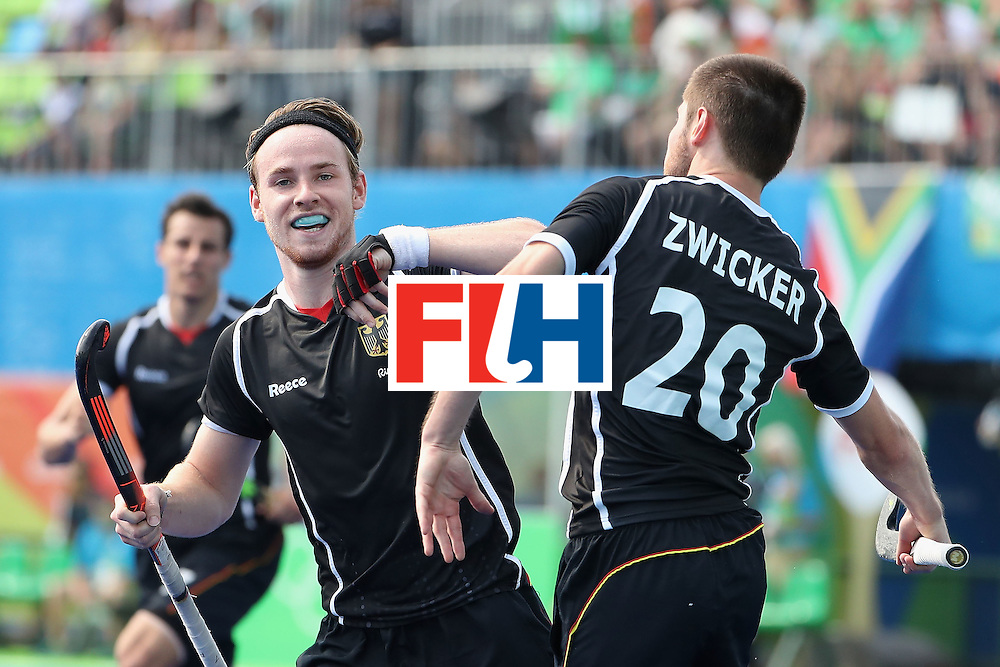 RIO DE JANEIRO, BRAZIL - AUGUST 09:  Martin Zwicker #20 of Germany celebrates alongside Christopher Ruhr #17 after Zwicker scored a goal against Ireland during the hockey game on Day 4 of the Rio 2016 Olympic Games at the Olympic Hockey Centre on August 9, 2016 in Rio de Janeiro, Brazil.  (Photo by Christian Petersen/Getty Images)