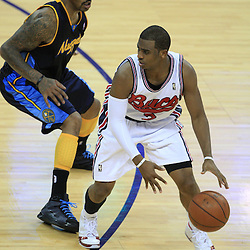 28 January 2009:  New Orleans Hornets guard Chris Paul (3) is defended by Denver Nuggets guard J.R. Smith (1) during a 94-81 win by the New Orleans Hornets over the Denver Nuggets at the New Orleans Arena in New Orleans, LA. The Hornets wore special throwback uniforms of the former ABA franchise the New Orleans Buccaneers for the game as they honored the Bucs franchise as a part of the NBA's Hardwood Classics series. .