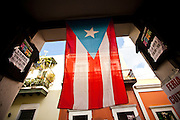 Puerto Rican flag hangs from a doorway in Old San Juan, Puerto Rico