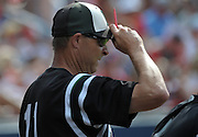 Roswell coach Mike Power signals in their GHSA AAAAAA State Baseball Championship game against Milton High School, Monday, May 27, 2013, in Milton, Ga.   David Tulis/AJC Special