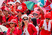 06 APRIL 2014 - BANGKOK, THAILAND: Red Shirt supporters dance at a Red Shirt rally in the Bangkok suburbs Sunday. Red Shirts and supporters of the government of Yingluck Shinawatra, the Prime Minister of Thailand, gathered in a suburb of Bangkok this weekend to show support for the government. The Thai government is dealing with ongoing protests led by anti-government activists. Legal challenges filed by critics of the government could bring the government down as soon as the end of April. The Red Shirt rally this weekend was to show support for the government, which public opinion polls show still has the support of most of the electorate.   PHOTO BY JACK KURTZ