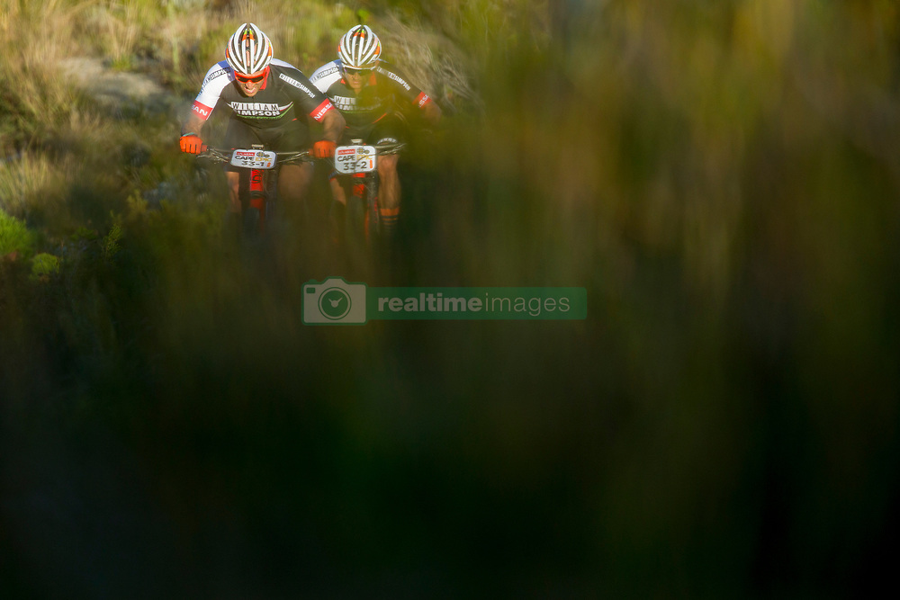 Michael Posthumus and Derrin Smith during stage 1 of the 2017 Absa Cape Epic Mountain Bike stage race held from Hermanus High School in Hermanus, South Africa on the 20th March 2017<br /> <br /> Photo by Greg Beadle/Cape Epic/SPORTZPICS<br /> <br /> PLEASE ENSURE THE APPROPRIATE CREDIT IS GIVEN TO THE PHOTOGRAPHER AND SPORTZPICS ALONG WITH THE ABSA CAPE EPIC<br /> <br /> ace2016