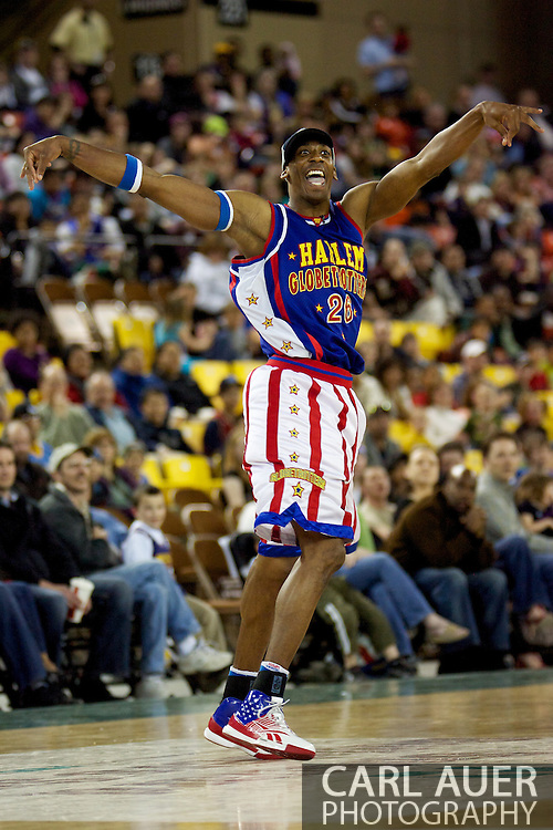 April 30th, 2010 - Anchorage, Alaska:  During a game of baseball during a timeout, Harlem Globetrotter Hi-Lite Bruton tries for a inside the court home run Friday night at the Sullivan Arena.