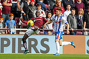 Hearts FC Defender Juwon Oshaniwa defends against Kilmarnock FC Forward Greg Kilties attack during the Ladbrokes Scottish Premiership match between Heart of Midlothian and Kilmarnock at Tynecastle Stadium, Gorgie, Scotland on 3 October 2015. Photo by Craig McAllister.