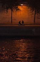 Paris, Couple at the Seine at night.