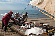 Traditional artesanal Balsa wood fishing raft on shore after a night of fishing<br /> Playas<br /> South Coast<br /> ECUADOR.  South America
