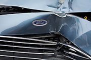 A detail of a crashed Ford car whose grill and bonnet has been crushed after a head-on collision, on 3rd February 2020, in London, England