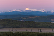 ull Moon setting over Rocky Mountains, taken from Rothney Astrophysical Observatory on August 28, 2007, night of total eclipse of the Moon. Umbral eclipse was over by moonset though the Moon was still in penumbral eclipse. Taken with Canon 20Da camera and 135mm lens at ISO800 and f/4.5 for 1/160 sec. Moon in blue of Earth's shadow on atmosphere.