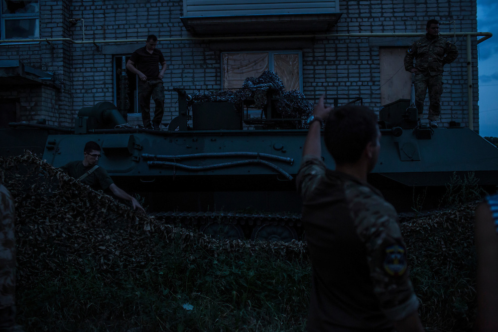 AVDIIVKA, UKRAINE - JULY 9, 2016: Ukrainian soldiers park an MT-LBu personnel carrier in Avdiivka, Ukraine. The town is now one of the most active areas of fighting along the line of control between the Ukrainian government and Russian-backed rebels. CREDIT: Brendan Hoffman for The New York Times