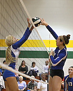 Wahlert's Alyssa Klostermann (7) and Washington's Shanay Gonder (18) joust over a ball during the MVC Volleyball Tournament semifinal game between the Wahlert Golden Eagles and the Washington Warriors at Kennedy High School in Cedar Rapids on Saturday October 13, 2012. Washington defeated Wahlert 25-13, 25-20.