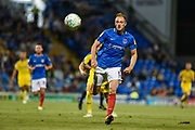 Portsmouth Defender, Matt Clarke (5) chases the ball during the Carabao Cup match between Portsmouth and AFC Wimbledon at Fratton Park, Portsmouth, England on 14 August 2018.