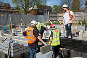 A group of builders laying foundations on new house construction site in Norwich. Norfolk. United Kingdom (photo by Andrew Aitchison / In pictures via Getty Images)