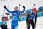 PYEONGCHANG-GUN, SOUTH KOREA - FEBRUARY 20: Dominik Windisch of Italy celebrates after finishing third while Arnd Pfeiffer of Germany is dejected during the Biathlon 2x6km Women + 2x7.5km Men Mixed Relay at Alpensia Biathlon Centre on February 20, 2018 in Pyeongchang-gun, South Korea. Foto: Nils Petter Nilsson/Ombrello                    ***BETALBILD***
