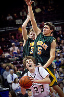 JEROME A. POLLOS/Press..Lake City's J.J. Stoddard draws a foul from Tony Buzzini, right, as his Borah High teammate Jeremy Jones comes in to assist in the defense during the first half of the T-Wolves 52-46 loss Thursday to the Lions at the state 5A basketball tournament.