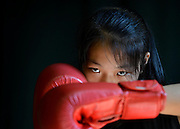 GUANGZHOU, CHINA -  (CHINA OUT) 2013/06/03<br /> <br /> Boxing Girls Of China<br /> Girls take part in a boxing training session in Guangzhou, Guangdong Province of China. <br /> <br /> Amateur sports schools were launched in China during the 1950s to develop the country's sporting prowess, with almost all such schools relying on government funding. Talented young children are rooted out and put in Amateur sports schools from as young as four years old.<br /> ©ChinaFoto/Exclusivepix